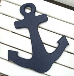 """Navy Blue Indoor Outdoor Anchor. Nautical nursery room wall anchor hanging, but also appealing in myriad settings as well. Washable outdoor anchors.Measures 10-1/2"""" wide x 12"""" tall and 5/8"""" thick. Each has a keyhole shape cut into the top back side (see photo) for hanging. Actual weight 10 oz.New beachhouse anchor wall art, made with heavy plastic, so can be used anywhere!100% recycled. Color is all the way through each item.…"""