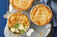 Filled with creamy chicken and topped with buttery pastry, these pot pies are just the thing to warm up with when the mercury starts to drop.