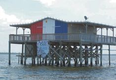 Stilt fishing houses in the Gulf of Mexico, just off the coast of Pasco County, Florida.
