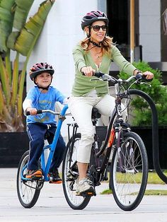 Sheryl Crow, in wayfarer sunnies, and her adorable son Wyatt cruise around on a two-person bike in sunny Cali! Looks like fun!