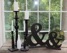 Black candle sticks and black ampersands look lovely with milk glass! available for rent from southernvintagegeorgia.com