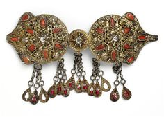 Silver gilt filigree belt clasp inset with carnelians, and five suspended pendants; Egypt, 1800-1884