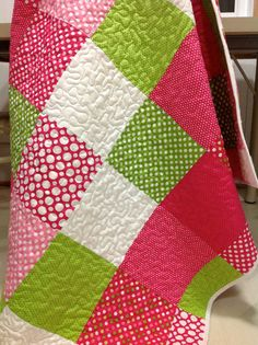 Baby Quilt SPOT ON in Lime Pink and White Modern Baby Girl Quilt. $140.00, via Etsy.