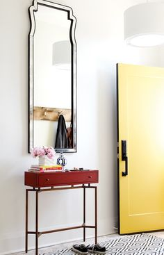 Chatelaine - entrances/foyers - yellow door, yellow front door, black and white rug, foyer ruf, black and white diamonds rug, red console ta...