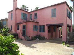 exterior and driveway. pink surprising works on this mediterranean inspired villa 1616 Broadway Galveston, TEXAS 77550