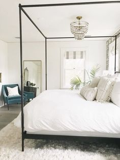 canopy bed with white bedding. White bedroom ideas, all white bedrooms, guest bedrooms that wow, guest bedrooms that make an impression, AirBnb bedroom ideas. how to have a hotel-like bedroom. clean…More How To Create A Modern Bedroom Neutral Bedroom Decor, All White Bedroom, White Bedding, Bedroom Inspo, Home Decor Bedroom, White Bedrooms, Bedroom Ideas, Bedroom Inspiration, Baby Bedroom