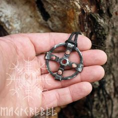This is a real forged iron handmade Viking style pendant. The pendant is an ancient symbol, the Solar cross, which is probably the oldest religious symbol in the world, appearing in Asian, American, European, and Indian religious art from the dawn of history. Composed of a equal armed cross within