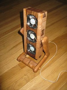 Cooling Fan Housing by Dan Lyke -- Homemade computer cooling fan housing intended to facilitate air circulation in a bedroom. Constructed from maple and Koa with an integral tilting feature. http://www.homemadetools.net/homemade-cooling-fan-housing