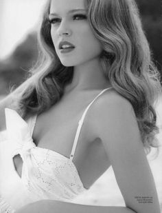 Love her vintage style- the hair and makeup work so well with her sundress/bathing suit