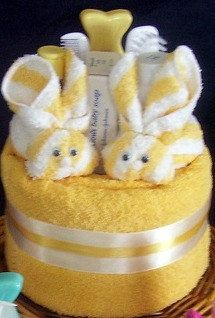 Yellow towel cake with boo boo bunnies
