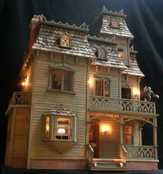 ...dollhouse lights aglow...this photo posted in an article of the May issue of American Miniaturist magazine 2009