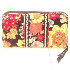 Vera Bradley Wallet This wallet has many card holders and three divisions inside! I have had this wallet for about two years but have not been consistant in using it, although it is perfect for spring or Fall! Vera Bradley Bags Wallets