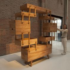 Sewing box cabinet by Kiki van Eijk - very cool!!  See it in action, all  mechanical, no electronics or motors.