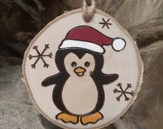 How to Make a Needle-Felted Penguin - to Make a Needle-Felted Penguin - Burned Ornament -- Santa Penguin, wood slice, Christmas ornamentSanta Penguin wood burned ornament. These ornaments are Penguin Ornaments, Wood Ornaments, Ornament Crafts, Xmas Ornaments, Christmas Decorations, Picture Ornaments, Wood Slice Crafts, Wood Burning Crafts, Wood Burning Patterns