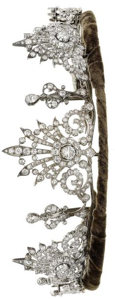 A diamond tiara, circa 1890. Composed of three starburst motifs, the largest at the centre, interspersed with stylised trefoil motifs, set throughout with cushion-shaped, old brilliant, single and rose-cut diamonds, cushion-shaped, old brilliant and single-cut diamonds