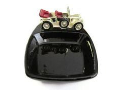 Model of a 1911 Daimler mounted securely on a black ceramic ashtray or trinket dish. Made in England late 50s - mid 60s. Lesney was a British