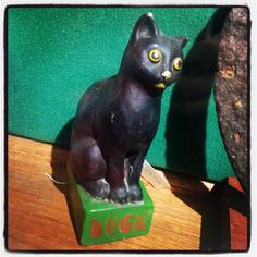 Lucky black cat figure from the @witchmuseum