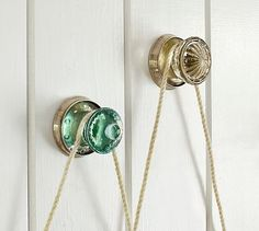 """Vintage Glass Frame Hangers; Echoing the look of glass knobs from another era, these sculptural hangers bring an eclectic element to artwork and photo displays.Blue: 3.5"""" diameter, 3.5 deep Clear: 3.5"""" diameter, 2.75"""" deep  Made of molded glass and brass, and finished in Antique Nickel.#potterybarn"""