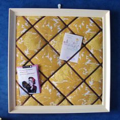 Fabric notice board - old frame, paint, backing board, wadding/old fleece,fabric, glue gun, upholstery pins and ribbon