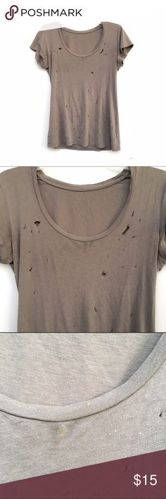 Distressed Hole T-Shirt Light brown tee with hole cut-outs throughout the front. Back only has one small hole, unnoticeable. Small stains on neckline. Size tag has faded, would fit sizes small to medium. Tops Tees - Short Sleeve