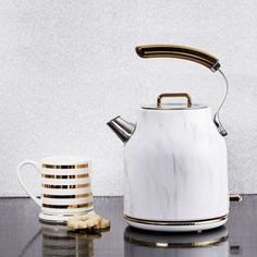 Decorated with a marble effect finish and complete with gold effect trims, this stylish litre kettle has been designed with a clear water level gauge printed with cup markings and features a rapid boil element. Kitchen Interior, Kitchen Design, Cord Storage, Kitchen Worktop, Marble Effect, Venetian Mirrors, Cooking Utensils, Kitchen Items, Retro Design