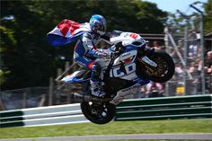 Josh Brookes showing off at the British Superbike meeting at Cadwell Park, jumping the Mountain on his Tyco Suzuki GSX-R1000 superbike.