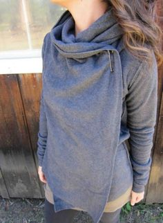 Made of fleece, for warmth and a little loose. the bunched material at the neck unfolds into a loose hood/