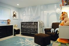 """This room is kind of gorgeous. It's combining Dwell bedding with a very modern take on artwork, and it is a great example of combining """"baby"""" with non-nursery furniture (that's a Wendy Bellissimo rocker there!)"""