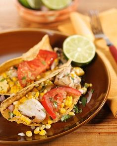 Grilled-Fish Tacos with Roasted-Chile-and-Avocado Salsa | Roast poblano peppers on a gas burner, grill, or under the broiler for the smoky salsa that dresses up chef Emeril Lagasse's fish tacos made with meaty grilled halibut.