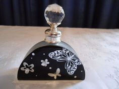 Vintage perfume bottle, Art Deco butterfly design - black and silver