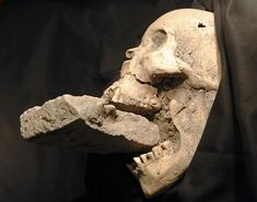 Proof that some myths have history to them: this was found in a mass grave in Italy. The brick was forced into the woman's mouth to prevent her from becoming a vampire. Because people didn't understand how the decaying body worked, many natural signs were taken to be supernatural. This was preventative. National Geographic did a whole article on it; it was fascinating.