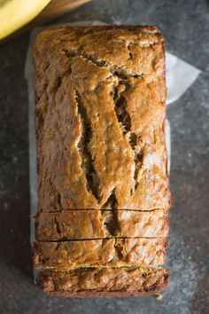 An overhead view of a loaf of Skinny Banana Bread. This Skinny Banana Bread is so incredibly moist, perfectly sweet, and delicious -- you would never know it's Healthy Bread Recipes, Banana Bread Recipes, Ww Recipes, Healthy Sweets, Healthy Baking, Dessert Recipes, Cooking Recipes, Family Recipes, Pie Cake