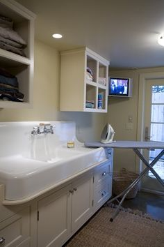 Nice big trough sink with drain boards built in on either side.  Would be great in a Laundry/Crafts Room and for flower arranging.  I would want more cabinets.