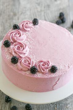 Soft and moist blackberry cake with fluffy blackberry lemon buttercream frosting. This blackberry lemon cake is sweet and tart with plenty of juicy berries!