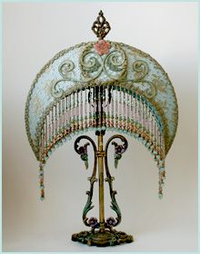 Lovely Art Nouveau Shade Once upon a time there was a beautiful butterscotch curved glass antique lamp.  Mother said do not give it to her!  I did give it to her for family peace.  So much for peace!  I not only gave it to her, but she also got my beloved family farm.  Peace!  Let it go!  K.W.