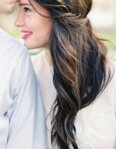 This half-up, half-down side swept hairstyle is perfect for any occasion.