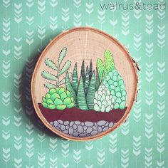 This mini wall hanging is a perfect holiday gift for the succulent enthusiast in your life. Hand painted succulent terrarium imagery on wood. Hanging fixture on back. Plant Painting, Wood Painting Art, Wood Paintings, Large Embroidery Hoop, Cute Embroidery, Alice In Wonderland Drawings, Cactus Drawing, Wood Burning Crafts, Cactus Decor