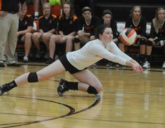 Ames' Allye Bodholdt dives for a dig against West Des Moines Valley on Tuesday. The Little Cyclones lost 3-2. Photo by Nirmalendu Majumdar/Ames Tribune