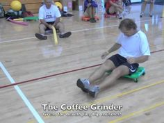 A variety of scooter board activities as demonstrated by the attendees of the Physical Education, Athletics, Coaching, and Health (PEACH) Workshop at Cal Pol...