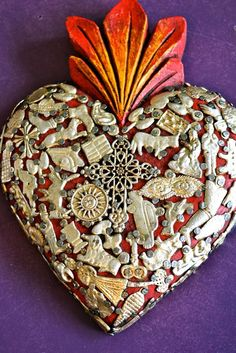 Mexican devotional art: the sacred heart with Milagros ©Mexico Import Arts Religious Icons, Religious Art, Tin Art, Mexican Designs, I Love Heart, Mexican Folk Art, Mo S, Sacred Heart, Heart Art