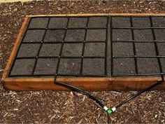 Square Foot Gardening method: The Garden Grid, from Garden in Minutes, is a pre-configured drip irrigation system that is said to set up in just minutes, and is equally at home on garden beds in the ground as well as raised beds.Video: https://www.youtube.com/watch?feature=player_embedded&v=fsxphdMgFqo
