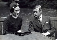 """The Prince of Wales Edward Albert Christian George Andrew David, later King Edward VIII """"David"""" (23 Jun 1894-28 May 1972), later Duke of Windsor, UK & his mistress Bessie Wallis Warfield Spencer-Simpson-Windsor (19 Jun 1896-24 Apr 1986) USA in a garden. Unknown place, unknown photographer in 1935 of Life, Spaarnestad Photo Studio."""