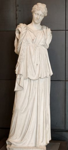 Woman wearing the chiton. Parian marble, Roman artwork, probably after an Hellenistic model of a Muse playing the lyre.