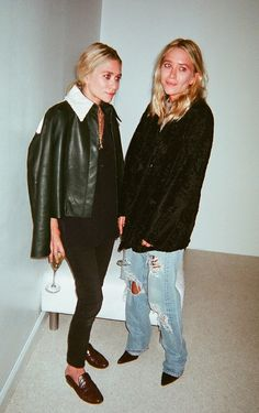 OLSENS ANONYMOUS MKA MARY KATE ASHLEY OLSEN FASHION STYLE BLOG CANDID ELIZABETH AND JAMES SS 2014 PRESENTATION GREEN LEATHER JACKET SHEARLING COLLAR CROPPED BLACK JEANS FLAT BROWN THE ROW SLIP ON FLATS LOAFERS BLACK CURLY LAMB FUR COAT BAGGY DISTRESSED RIPPED DENIM JEANS BLACK PUMPS SATIN WASHED  SILK BUTTON UP SHIRT  VIA WHEN IM NOT NAKED photo OLSENSANONYMOUSMKACANDIDELIZABETHANDJAMESSS2014PRESENTATIONDISTRESSEDDENIM.png