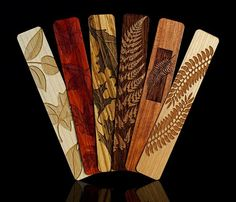 Beautiful handmade wood bookmarks. $14 per bookmark, $42 for the set. Includes inlay, laser engraved and solid wood.