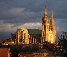 The French medieval Cathedral of Our Lady of Chartres. The cathedral is in exceptional state of preservation. The majority of the original stained glass windows survive intact, while the architecture has seen only minor changes since the early 13th century. The building's exterior is dominated by heavy flying buttresses which allowed the architects to increase the window size,while the west  a 349 ft plain pyramid completed around 1160 & a 16th century a 377 ft Flaming spire.