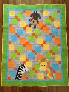 Baby quilt I made for my first grandchild due next month. Disappearing nine patch with jungle animals in gender neutral colors.