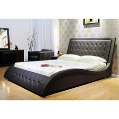 Modern and unique, this California king upholstered bed is stylish and functional. This platform bed is upholstered in faux leather and features a one-of-a-kind wave shape that is eye-catching and ele