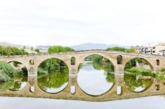 romanesque bridge over river Arga, Puente La Reina, Road to Santiago. Spain Images, Nyc, Romanesque, Photo Library, Places To Go, Mexico, Outdoor Structures, River, Stock Photos