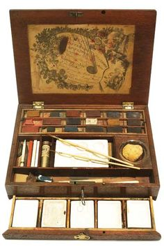 Watercolour Box 1796-1827.  Original colours - glass water pot, five china mixing tiles and replacement china palette. Watercolour painting was considered a great accomplishment for young Regency ladies such as Elinor Dashwood and Emma Woodhouse